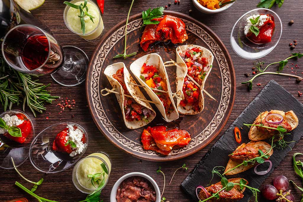 Crowd-Pleasing Tasting Themes - Mexican tacos, taco fixings and red wine