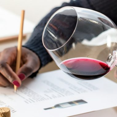 Pointless Wines? Woman scoring and analyzing wine