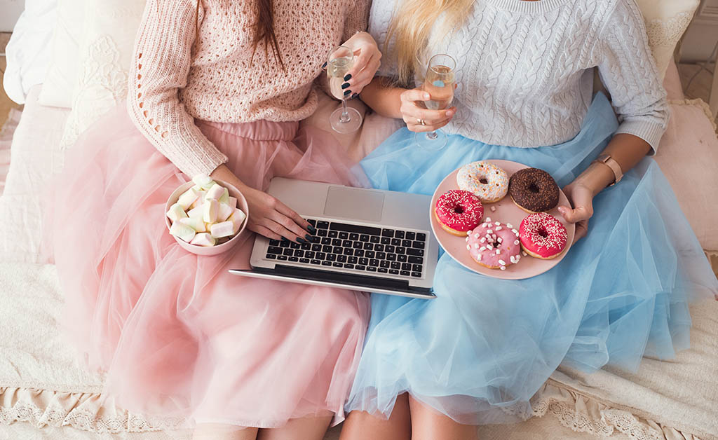 Sorority sisters having sweets with wine while on a Virtual Tasting